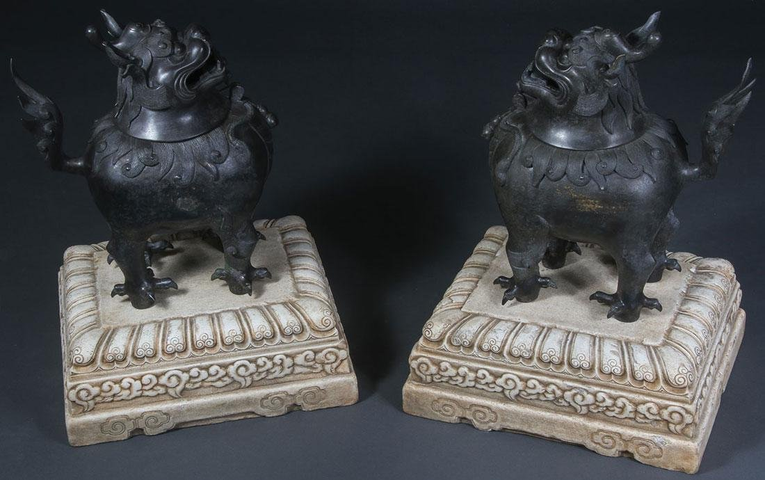 A PAIR OF CHINESE BRONZE FOO DOGS