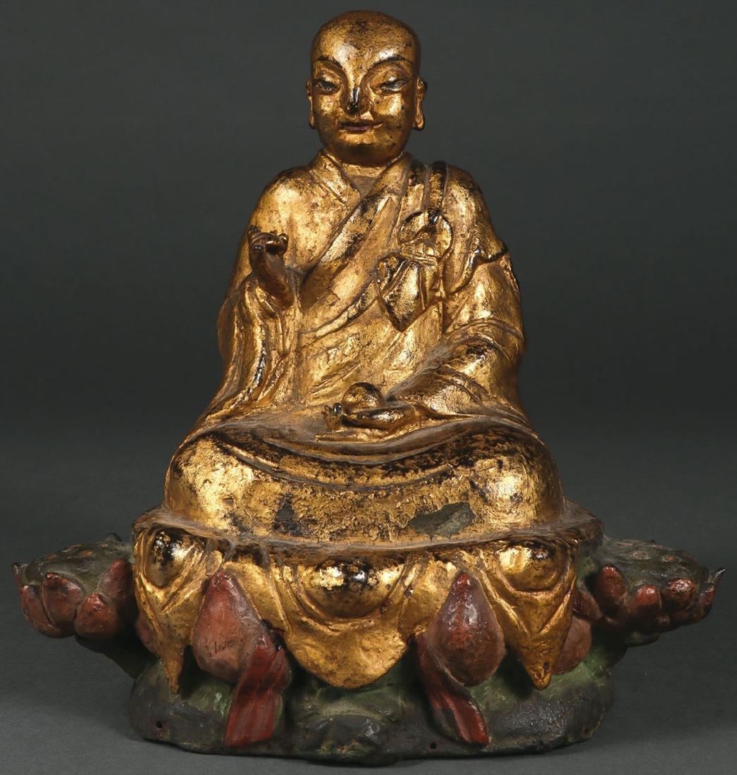 A SINO-TIBETAN POLYCHROME AND GILT BRONZE BUDDHA