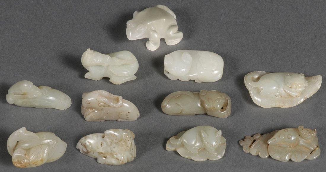 A GROUP OF TEN CHINESE CARVED JADE PENDANTS
