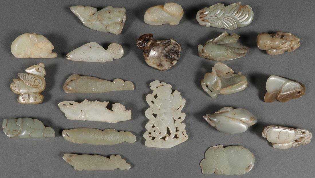 A GROUP OF TWENTY CHINESE CARVED JADE PENDANTS