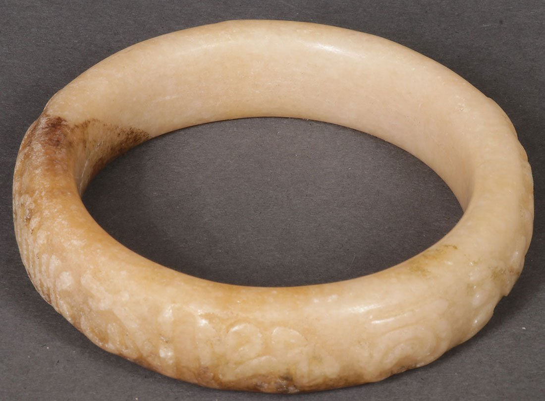 FOUR CHINESE CARVED JADE AND HARDSTONE BRACELETS - 5