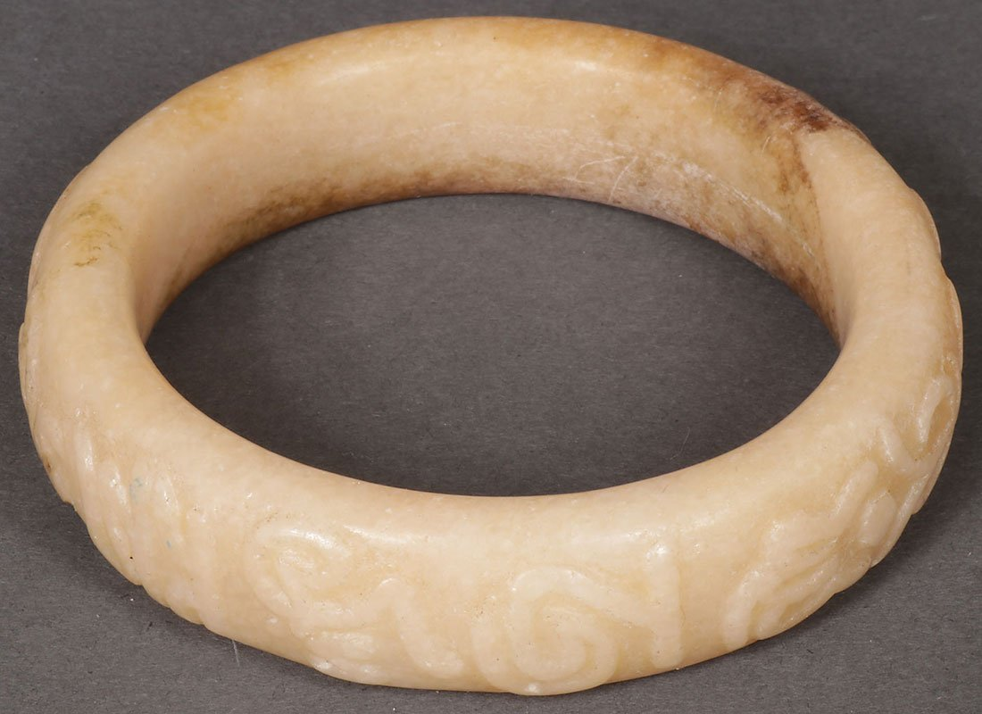 FOUR CHINESE CARVED JADE AND HARDSTONE BRACELETS - 6