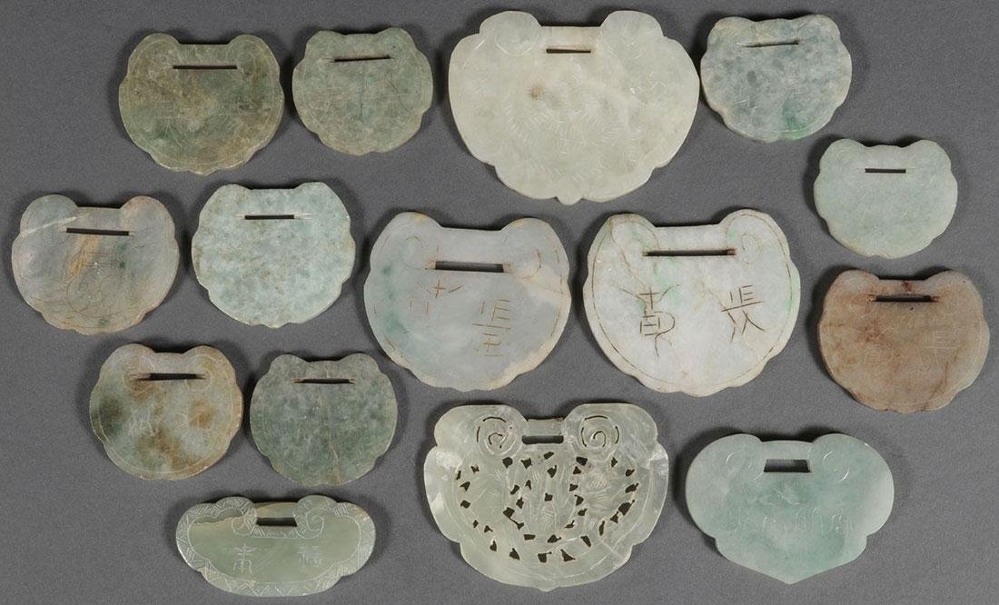 A GROUP OF FIFTEEN CHINESE CARVED JADE PENDANTS