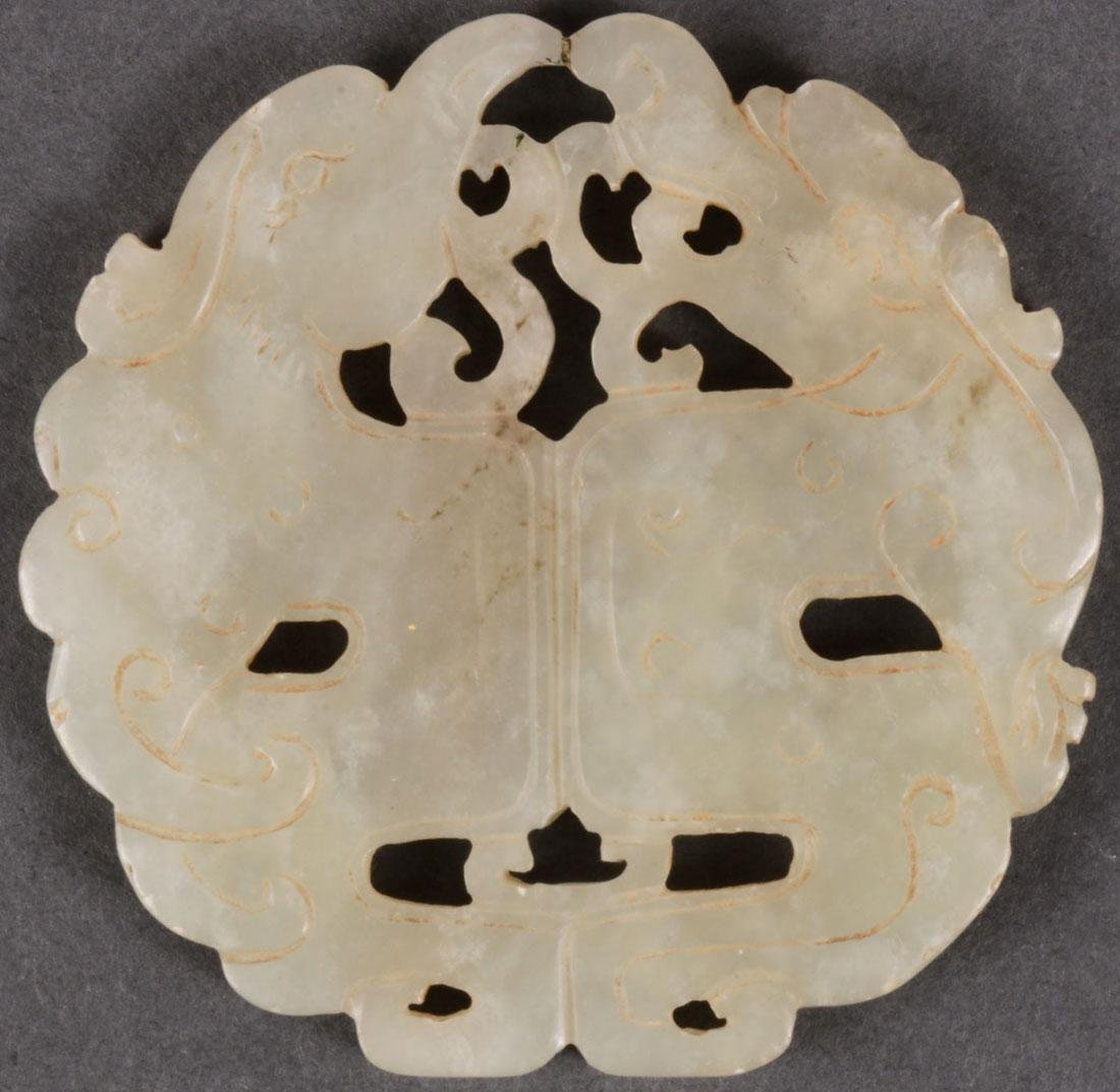 A GROUP OF SIX CHINESE CARVED JADE PENDANT DISCS - 7