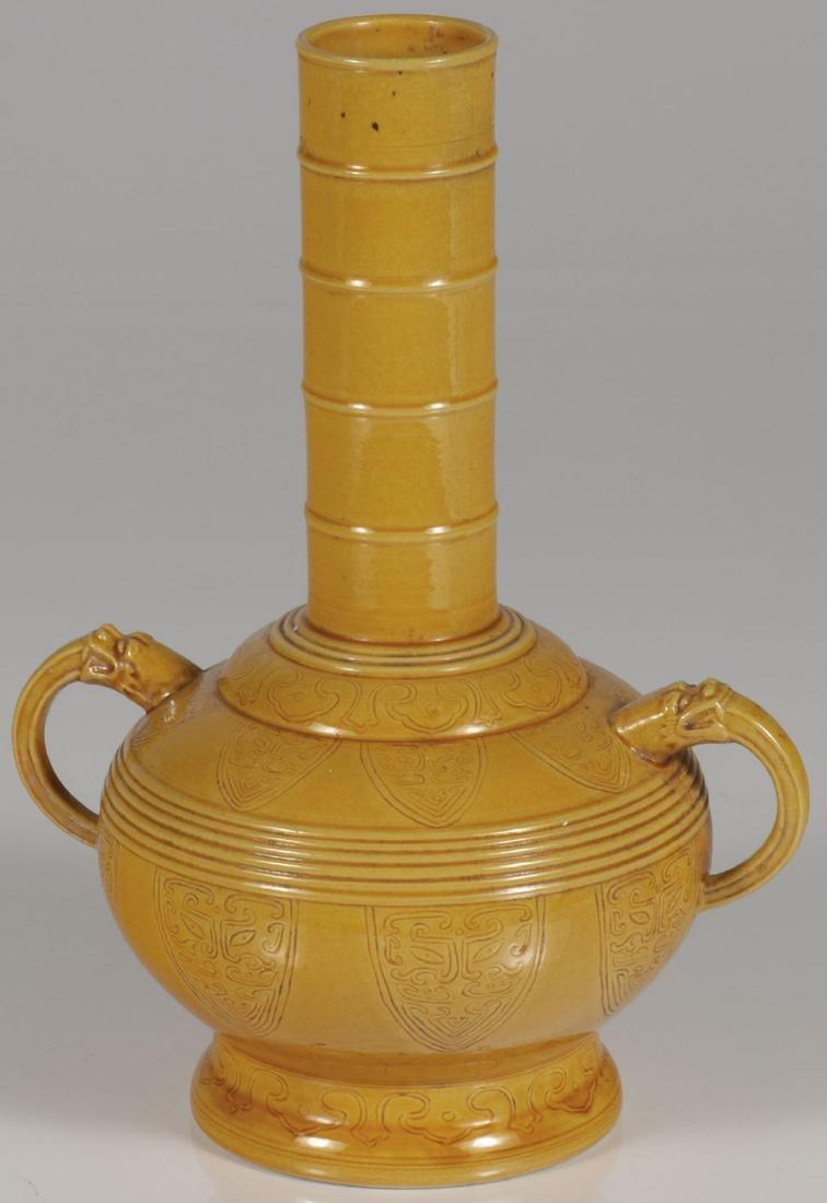 A CHINESE YELLOW GLAZED HANDLED VASE