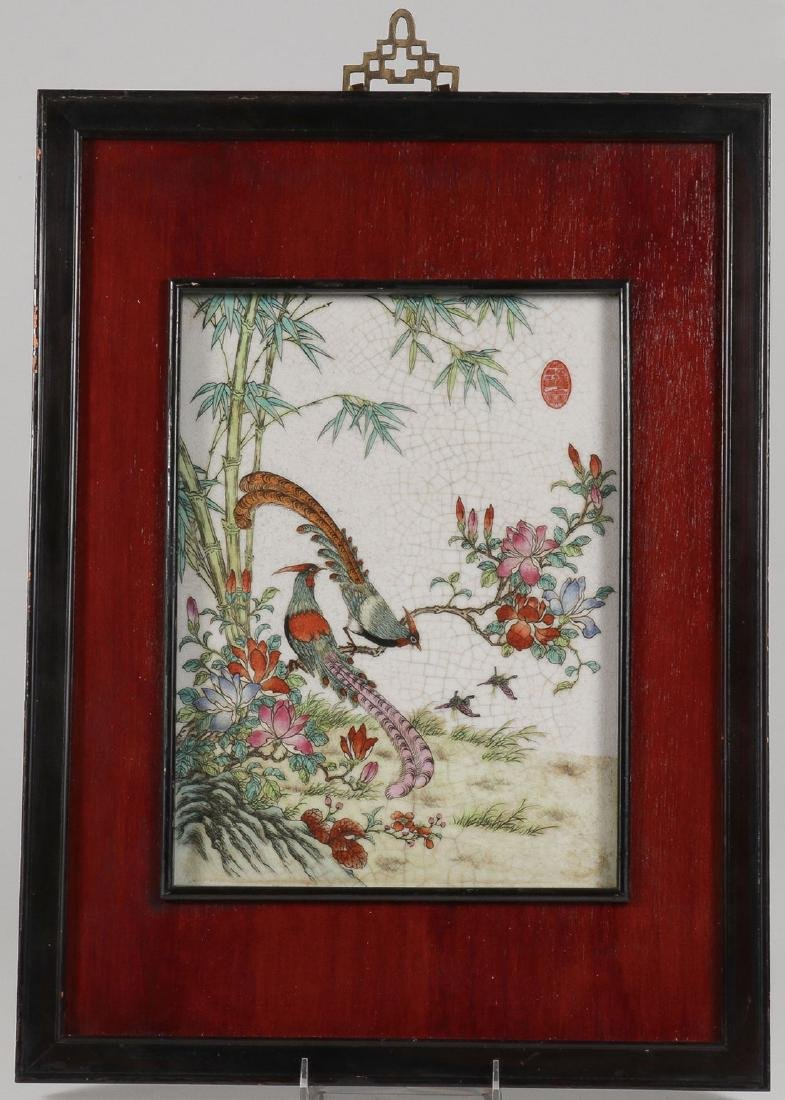 A CHINESE FAMILLE ROSE DECORATED PORCELAIN PLAQUE