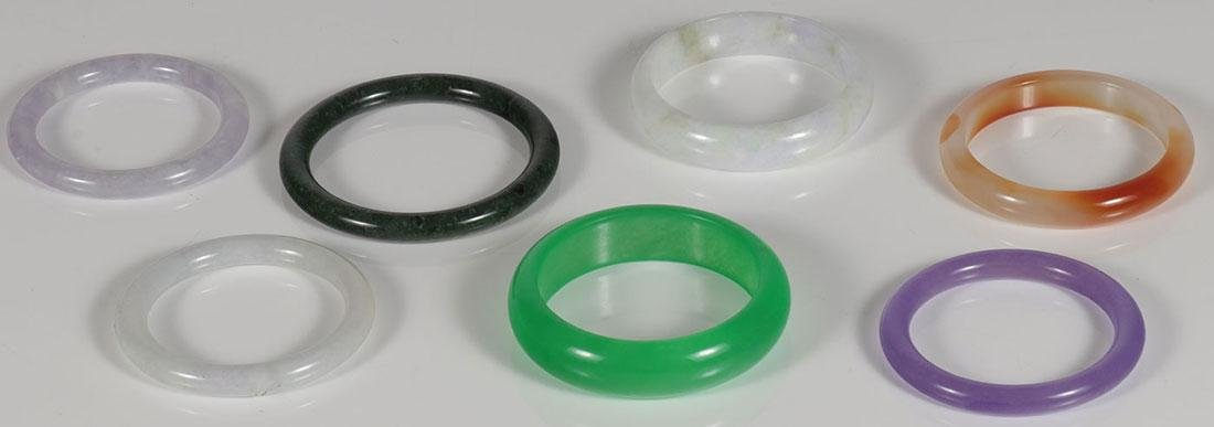 SEVEN CHINESE CARVED JADE BANGLES