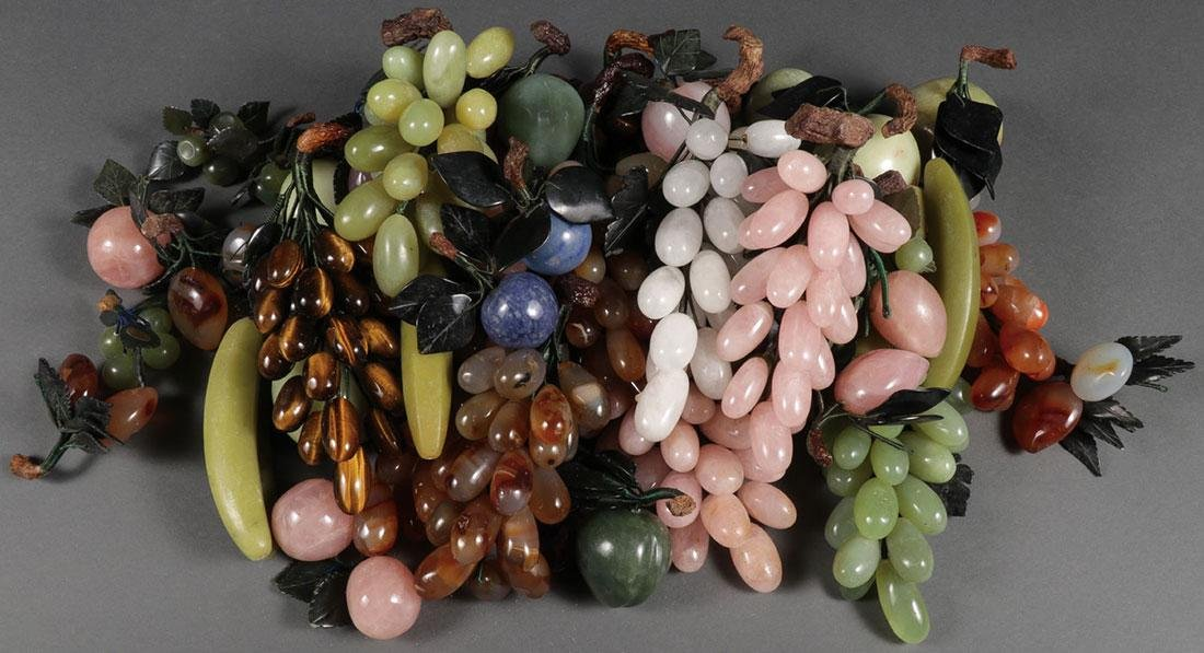 A GROUP OF CHINESE CARVED HARDSTONE FRUIT