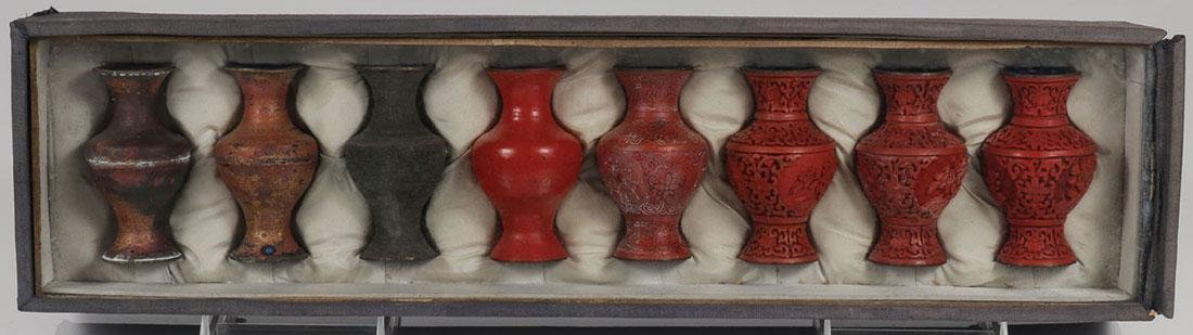 A CHINESE CASED CINNABAR PRODUCTION SET