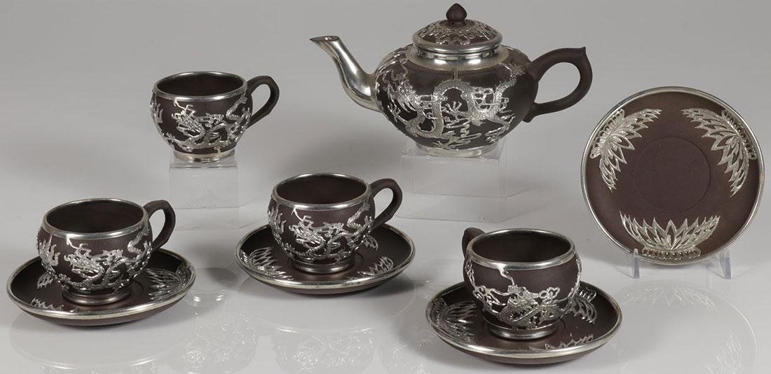 A CHINESE CERAMIC AND METAL OVERLAY TEA SET