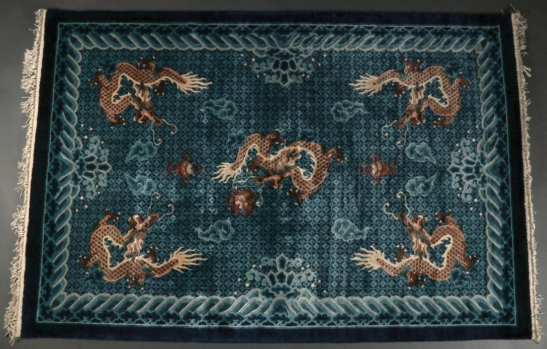 A CHINESE SCULPTED DRAGON RUG