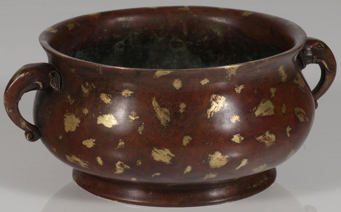 A CHINESE BRONZE AND GILT BOWL