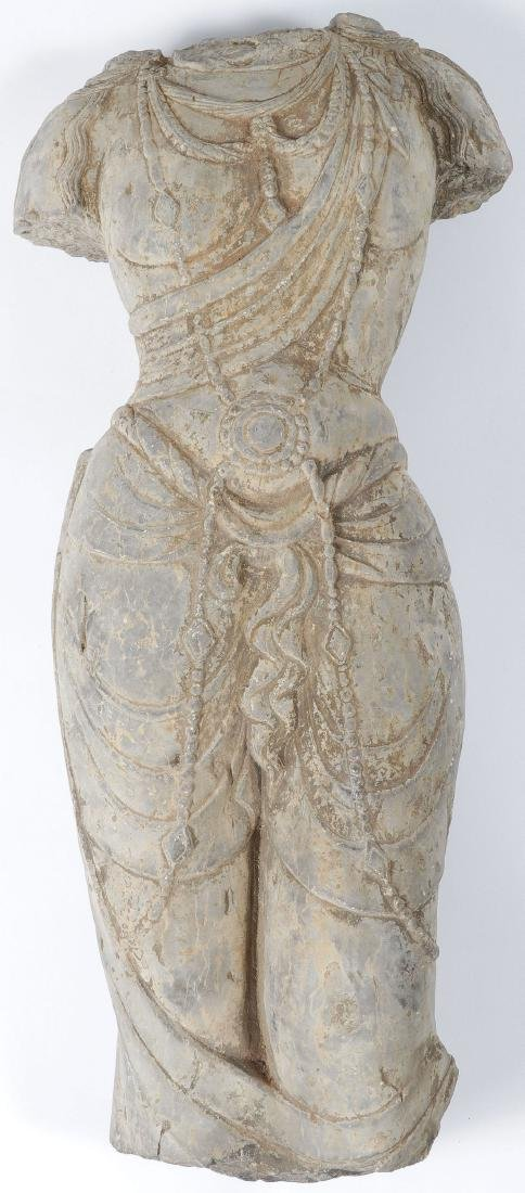 A CARVED/CAST STONE TORSO IN ANCIENT STYLE