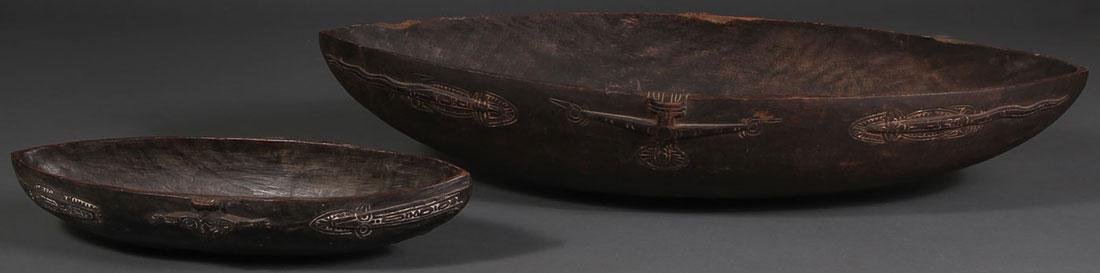 A PAIR OF CARVED WOOD TAMI ISLAND FEAST BOWLS