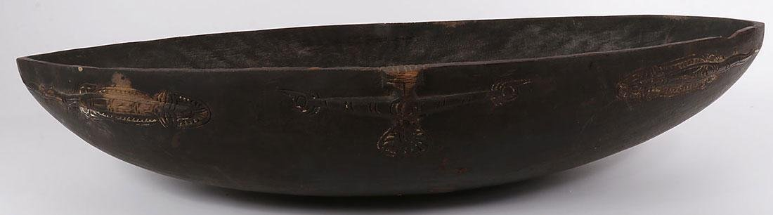 A PAIR OF CARVED WOOD TAMI ISLAND FEAST BOWLS - 2