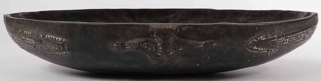 A PAIR OF CARVED WOOD TAMI ISLAND FEAST BOWLS - 7