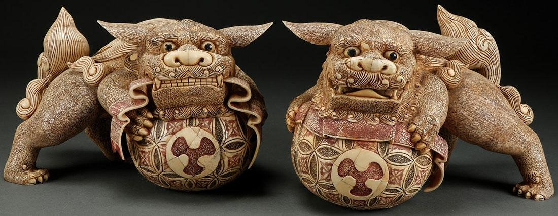 A PAIR OF CHINESE CARVED BONE TEMPLE LIONS