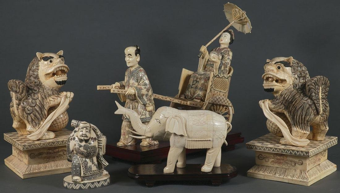 A GROUP OF SIX CHINESE CARVED BONE FIGURES