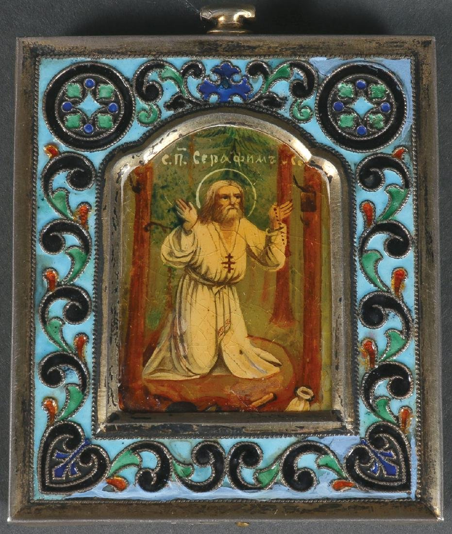 A RUSSIAN SILVER & ENAMEL ICON OF ST SERAPHIM