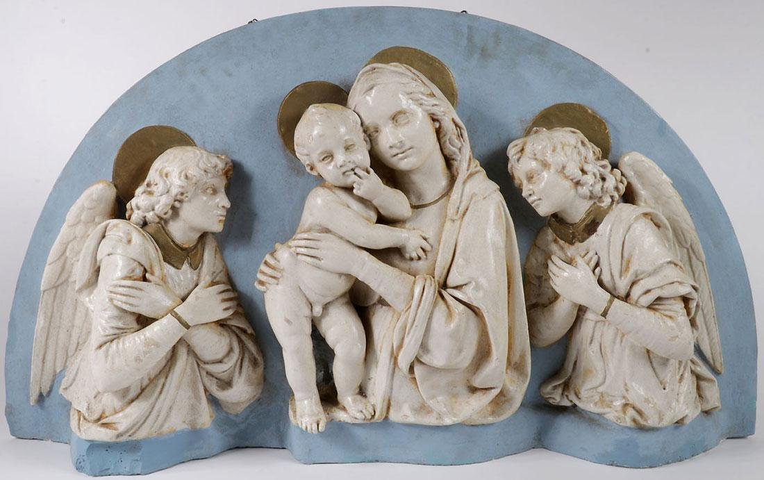 A CAST ARCHED PLAQUE OF THE VIRGIN AND CHILD C. 1890