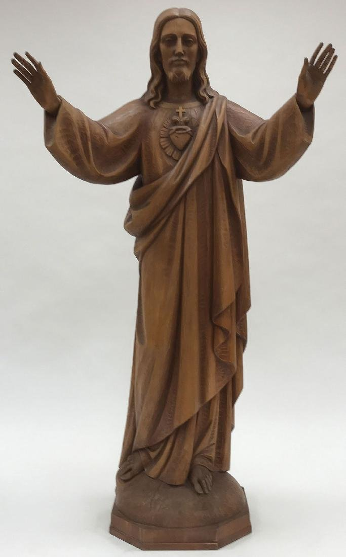 A CARVED WOOD FIGURE OF THE SACRED HEART OF CHRIS