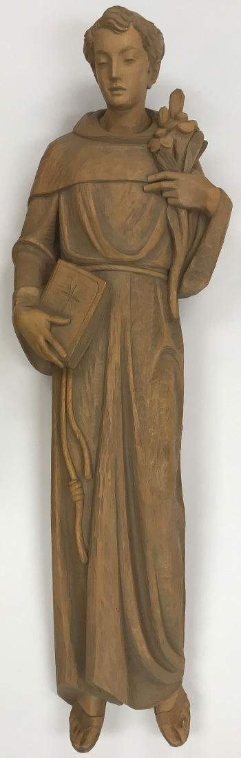 A CARVED WOOD FIGURE OF SAINT ANTHONY OF PADUA