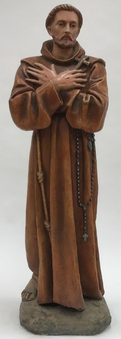 A POLYCHROME CAST FIGURE OF SAINT FRANCIS
