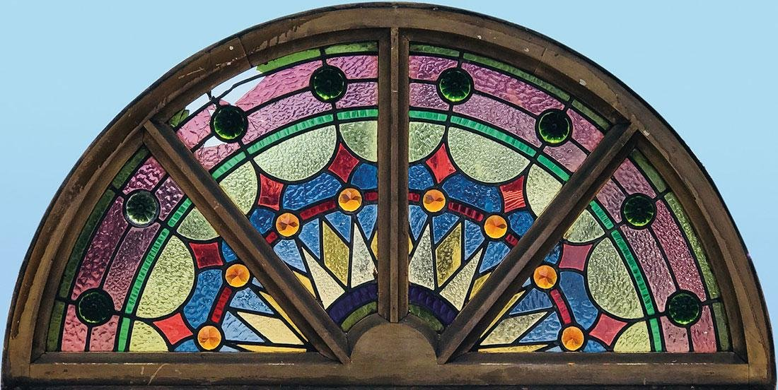 TWO STAINED AND LEADED GLASS LUNETTE WINDOWS