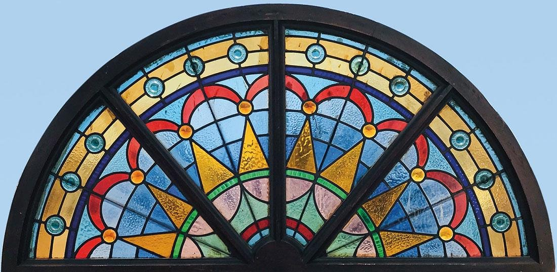 THREE STAINED AND LEADED GLASS LUNETTE WINDOWS