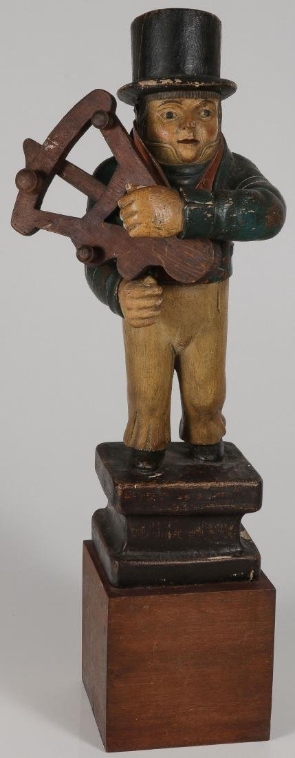 A CARVED AND POLYCHROME WOOD TRADE MARINER