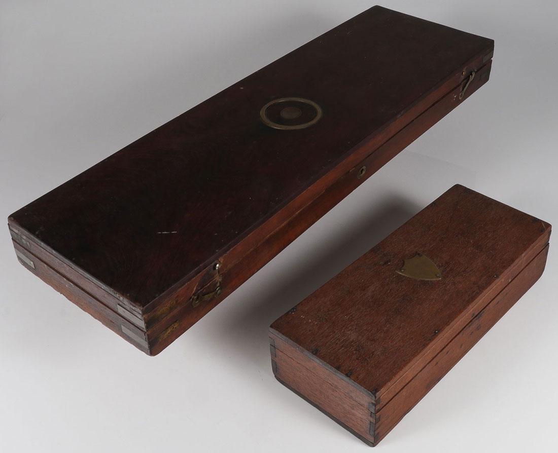 A PAIR OF WALNUT GUN CASES, 19TH CENTURY