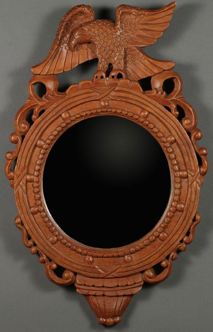A CARVED WOOD FRAME AND MIRROR