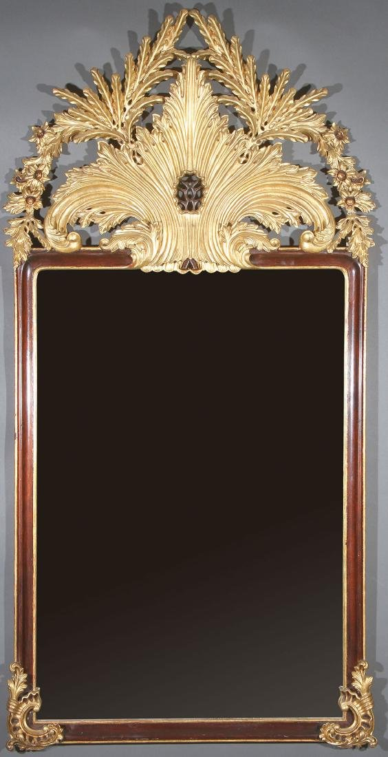 AN ANTIQUE STYLE CARVED MAHOGANY & GILT MIRROR