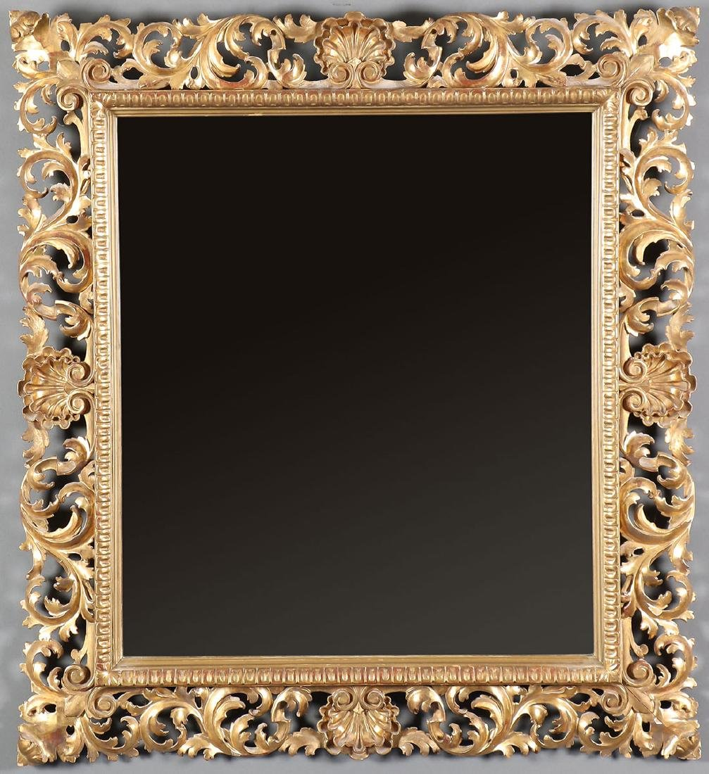 A FLORENTINE CARVED AND GILT WOOD MIRROR, 19TH C.