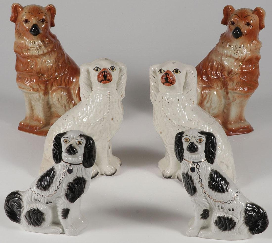 THREE PAIRS OF STAFFORDSHIRE STYLE DOGS
