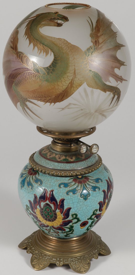 A FAIENCE OIL LAMP WITH DRAGON GLOBE 19TH C.