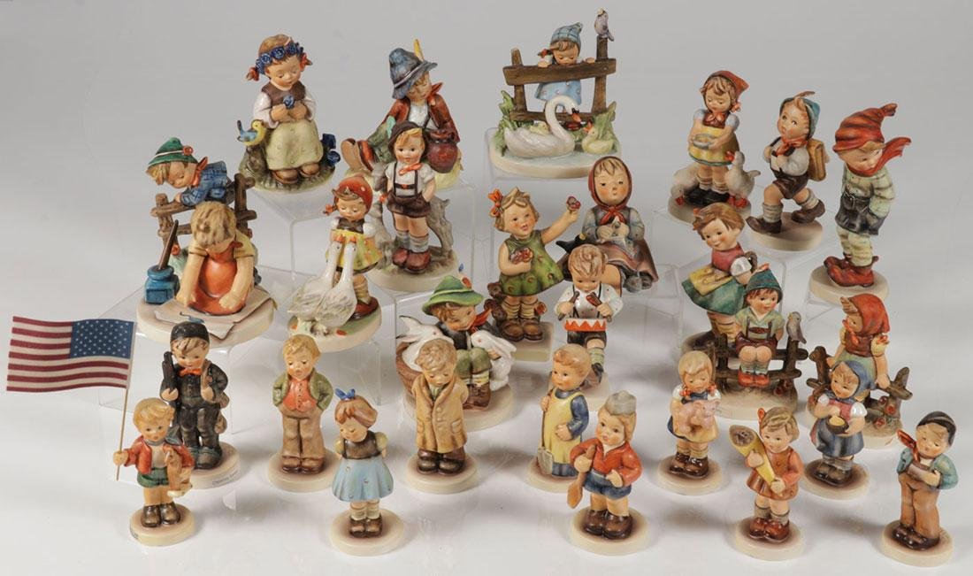 A GROUP OF 48 HUMMEL FIGURINES