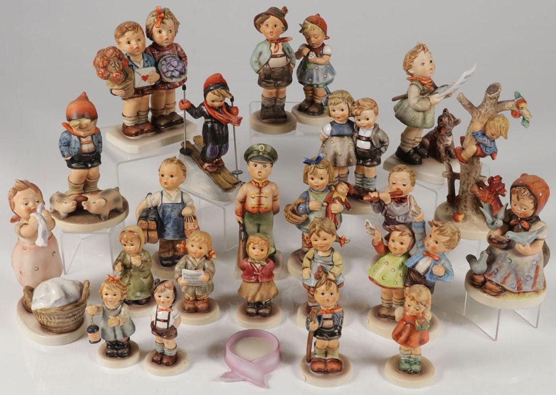 A GROUP OF 47 HUMMEL FIGURINES