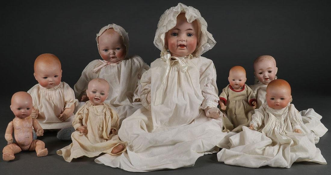 A GROUP OF EIGHT GERMAN BISQUE HEAD DOLLS