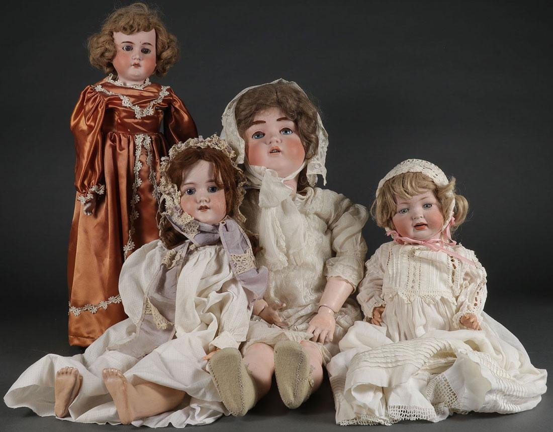 FOUR GERMAN BISQUE HEAD DOLLS