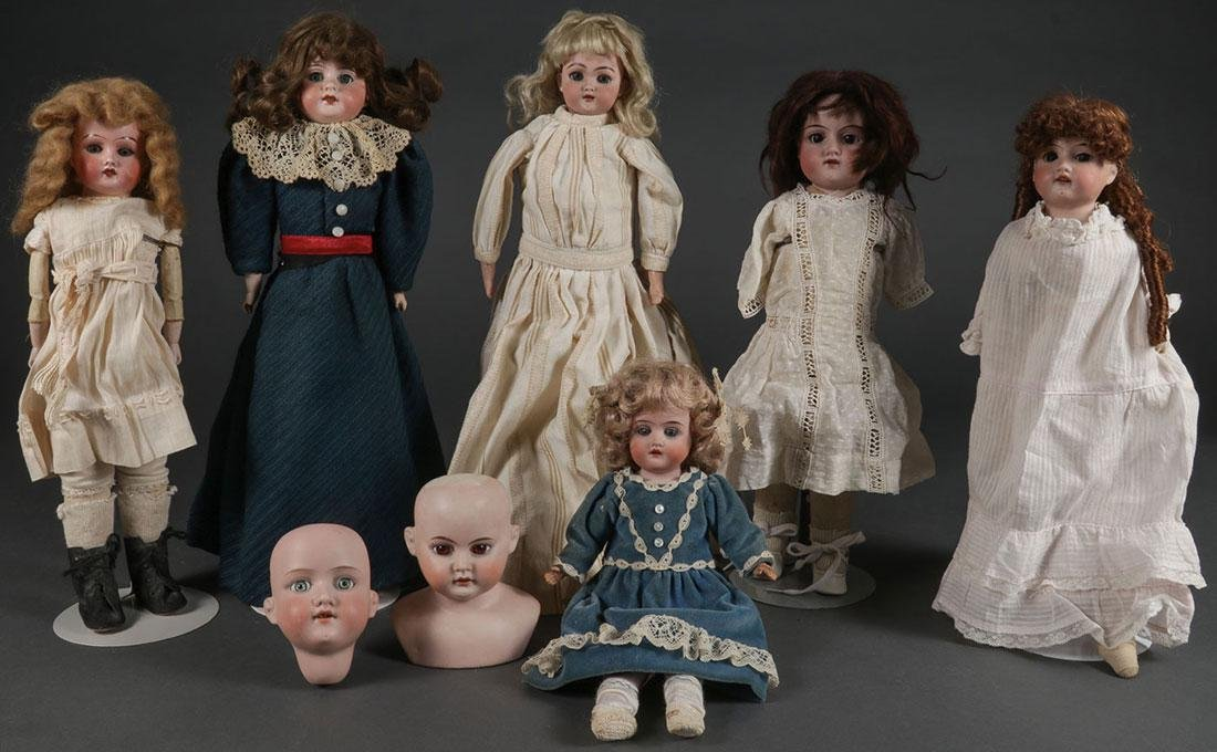 EIGHT GERMAN BISQUE DOLL HEADS
