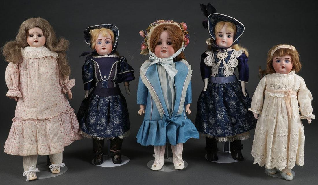 FIVE GERMAN BISQUE HEAD DOLLS