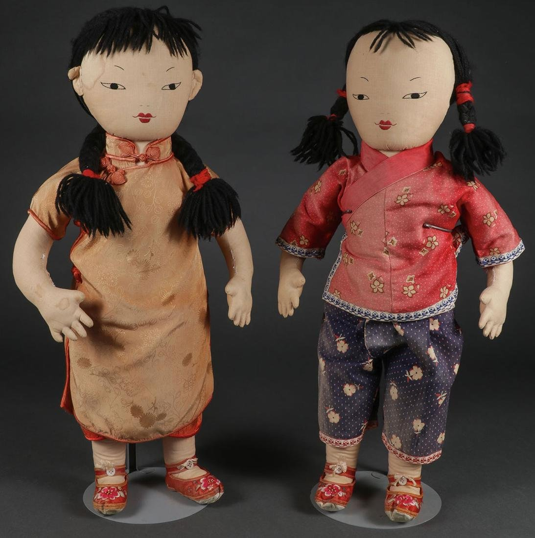 A PAIR OF CHINESE EMBROIDERED CLOTH DOLLS
