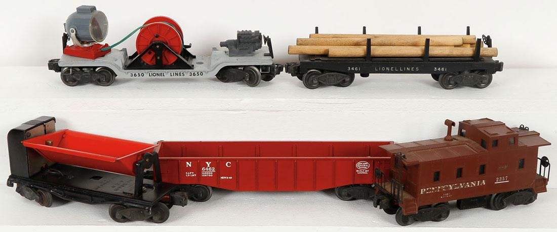 A GROUP OF TOY TRAINS AND ACCESSORIES