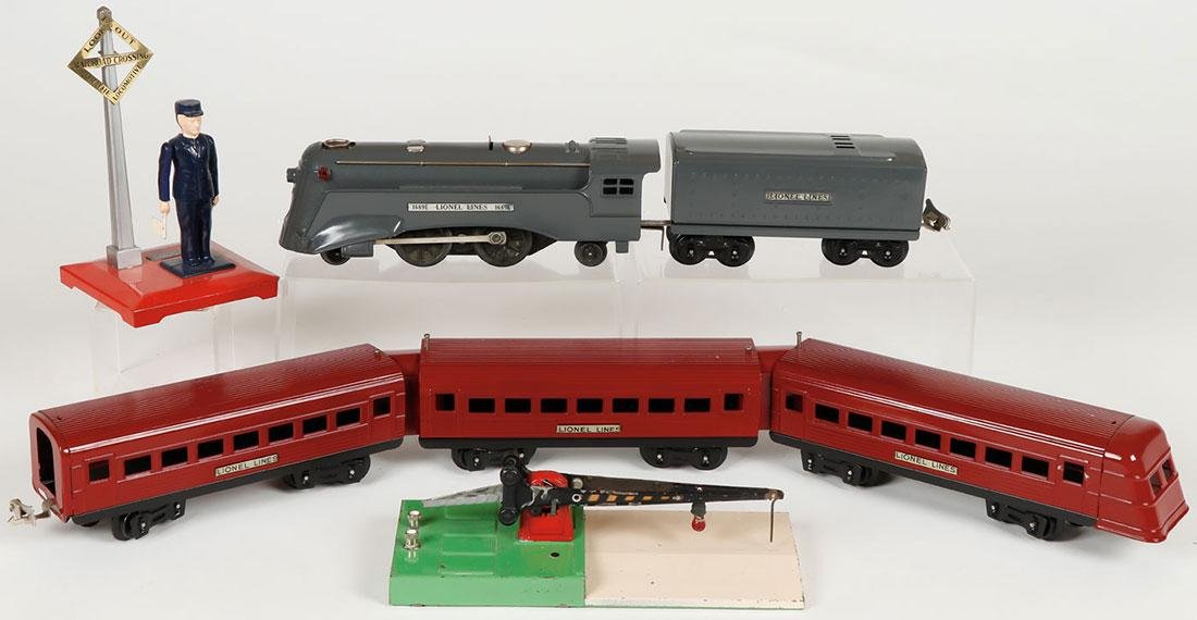 A GROUP OF TOY TRAINS AND ACCESSORIES - 2