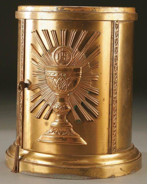 679: TABERNACLE; a cylindrical gilt bronze tabernacle;