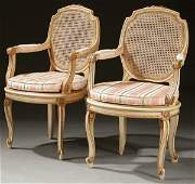 807 A PAIR OF FRENCH PROVINCIAL ARMCHAIRS CREAM PAIN