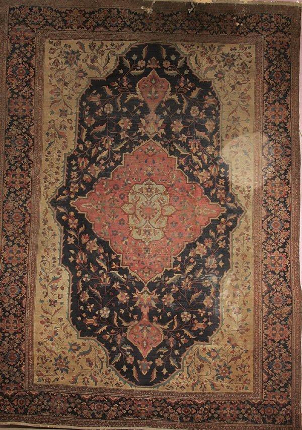 1185: A PERSIAN SAROUK HANDMADE RUG circa 1900. 12 feet