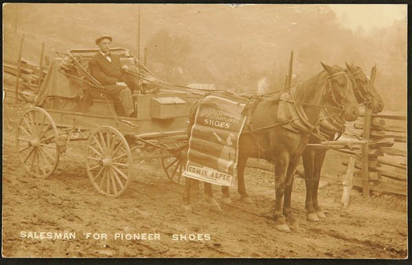 1504: A REAL PHOTO POSTCARD Pioneer shoes wagon