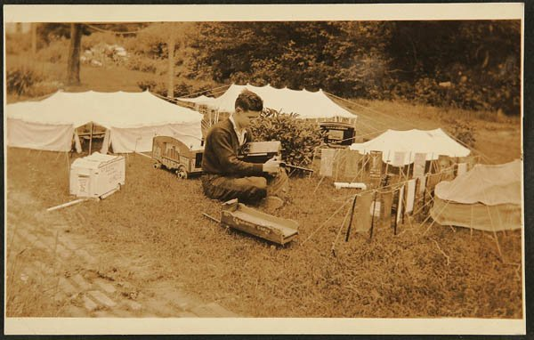 1505: POSTCARD SIZE PHOTOGRAPH  boy with toy circus